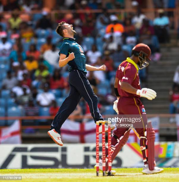 Mark Wood of England celebrates the dismissal of Shai Hope of West Indies during the 4th ODI between West Indies and England at Grenada National...