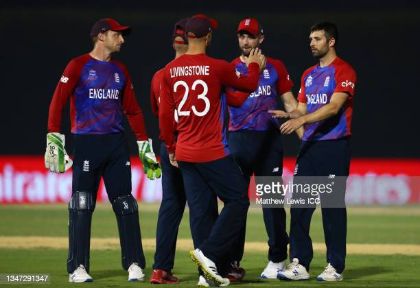 Mark Wood of England celebrates the wicket of KL Rahul of India during the India and England warm Up Match prior to the ICC Men's T20 World Cup at on...