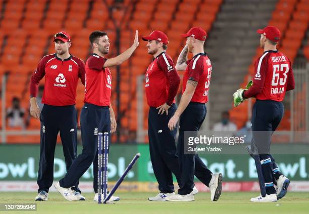 Mark Wood of England celebrates the wicket of KL Rahul of India with Dawid Malan, Jason Roy, Ben Stokes and Jos Buttler during the 3rd T20...