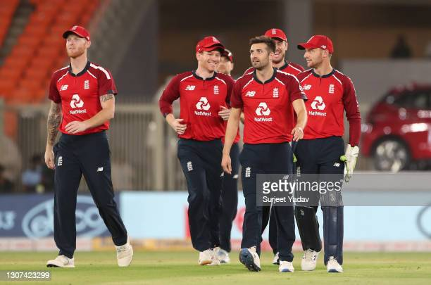 Mark Wood of England celebrates the wicket of KL Rahul of India with Ben Stokes, Eoin Morgan and Jos Buttler during the 3rd T20 International between...