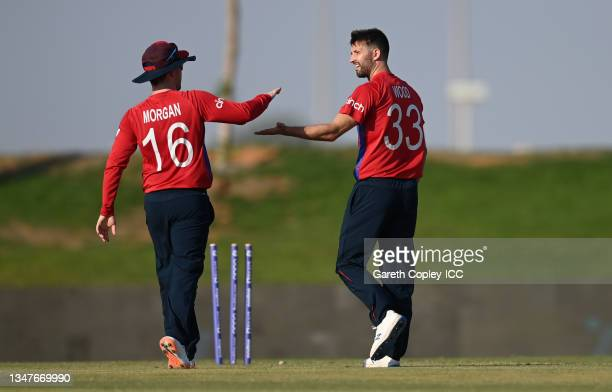 Mark Wood of England celebrates with Eoin Morgan after dismissing Tim Seifert of New Zealand during the England and New Zealand warm Up Match prior...
