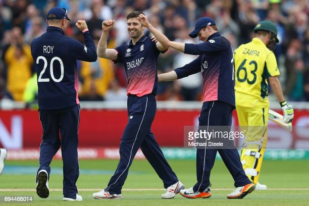 Mark Wood of England celebrates with Eoin Morgan and Jason Roy after bowling Adam Zampa of Australia during the ICC Champions Trophy match between...