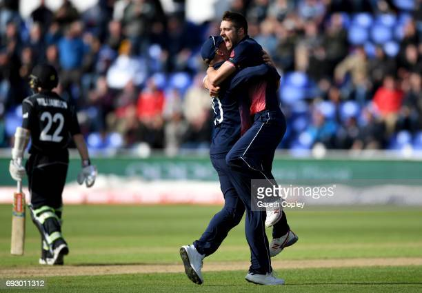 Mark Wood of England celebrates with Jason Roy after dismissing Kane Williamson of New Zealand during the ICC Champions Trophy match between England...
