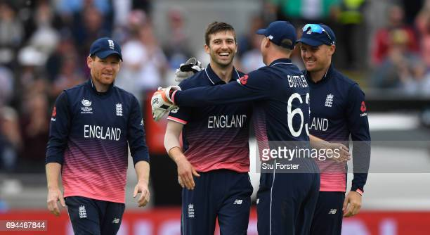 Mark Wood of England celebrates with team mates after dismissing Adam Zampa during the ICC Champions Trophy match between England and Australia at...