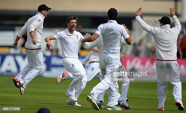 Mark Wood of England celebrates with teammates after dismissing David Warner of Australia during day one of the 4th Investec Ashes Test match between...