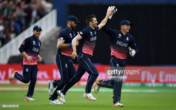 Mark Wood of England celebrates with teammates after dismissing Glenn Maxwell of Australia during the ICC Champions Trophy match between England and...
