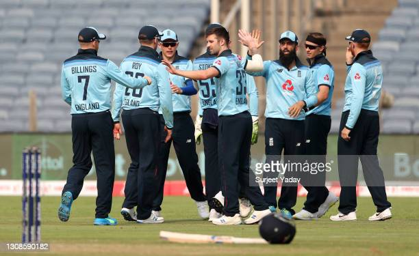 Mark Wood of England celebrates with teammates after dismissing Virat Kohli of India during 1st One Day International between India and England at...