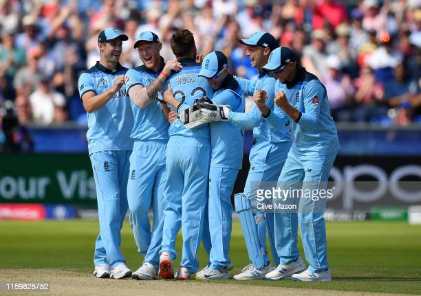 Mark Wood of England celebrates with the team as he runs out Kane Williamson of New Zealand during the Group Stage match of the ICC Cricket World Cup...