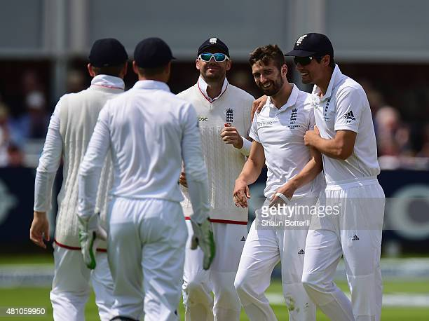 Mark Wood of England is congratulated by captain Alastair Cook aftervtaking the wicket of Michael Clarke of Australiaduring day two of the 2nd...