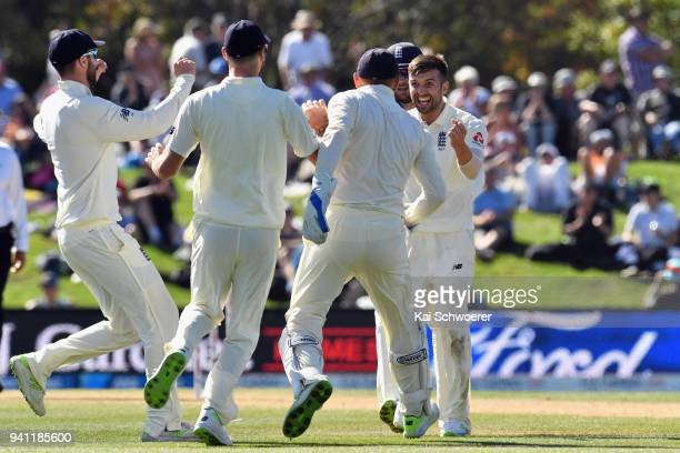 Mark Wood of England is congratulated by team mates after dismissing BJ Watling of New Zealand during day five of the Second Test match between New...