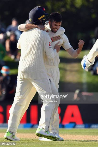 Mark Wood of England is congratulated by team mates after dismissing Colin de Grandhomme of New Zealand during day five of the Second Test match...