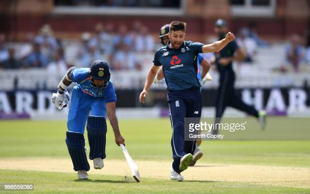 Mark Wood of England kicks at the ball to try to run out Shikhar Dhawan of India during the 2nd ODI Royal London OneDay match between England and...