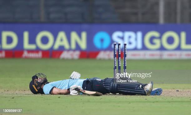 Mark Wood of England reacts after being run out during the 3rd One Day International match between India and England at MCA Stadium on March 28, 2021...