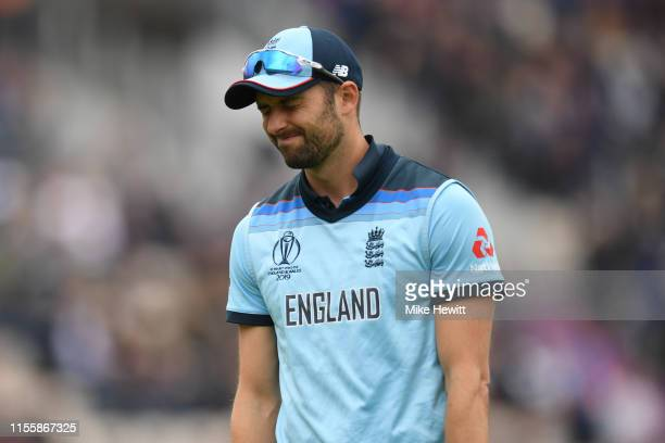 Mark Wood of England reacts after dropping a difficult chance from Chris Gayle during the Group Stage match of the ICC Cricket World Cup 2019 between...