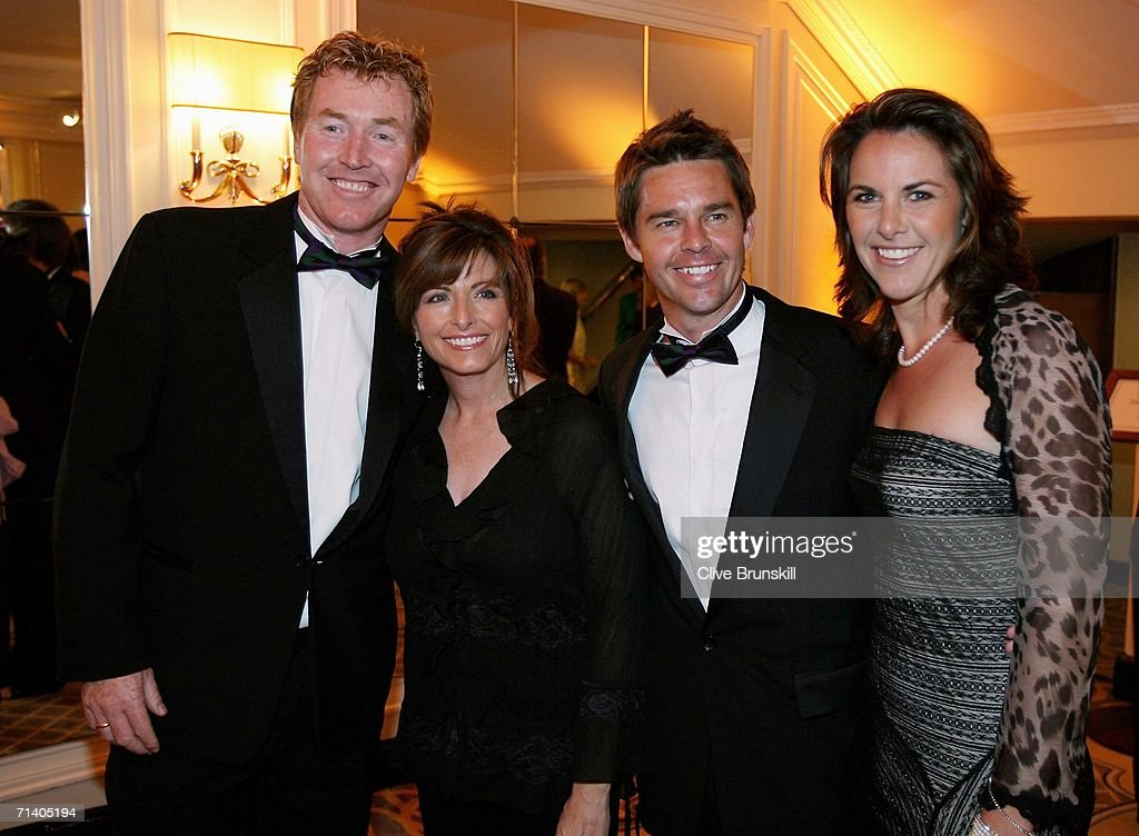 Mark Woodforde (L) and Todd Woodbridge (2nd-R) of Australia and partners attend the Wimbledon Winners' Dinner at the Savoy Hotel on July 9, 2006 in London, England.