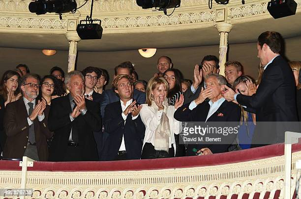 Mark Woodward Sir Tom Jones Oliver Bacharach and Jane Hansen applaud Burt Bacharach at the curtain call during the press night performance of Close...