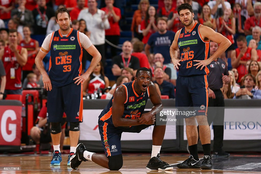 Mark Worthington, Nnanna Egwu and Stephen Weigh of the Taipans react after Bryce Cotton of the Wildcats was fouled in the dying seconds of the game during the round 16 NBL match between the Perth Wildcats and the Cairns Taipans at Perth Arena on January 20, 2017 in Perth, Australia.