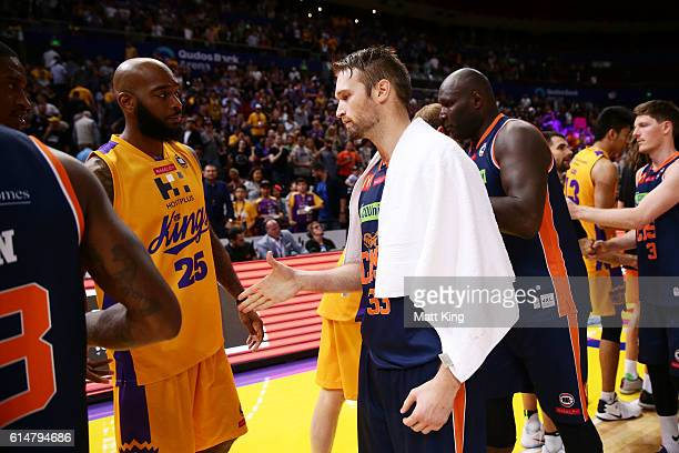 Mark Worthington of the Taipans shakes hands with Josh Powell of the Kings after the round two NBL match between the Sydney Kings and the Cairns...