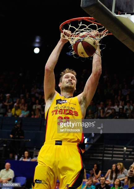 Mark Worthington of the Tigers makes a slam dunk during the round 10 NBL match between the Townsville Crocodiles and the Melbourne Tigers at...