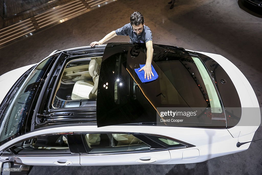 TORONTO ON FEBRUARY 17 Mark Woyslaw Wipes Clean The Retractable Panoramic  Roof 2014 Lincoln MKZ Hybrid