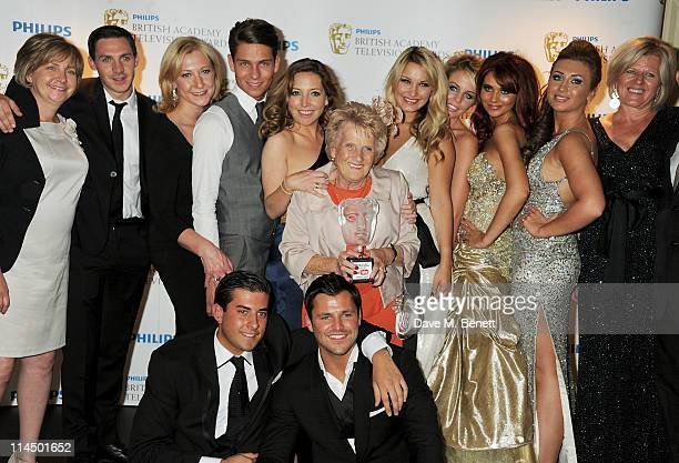 Mark Wright Amy Childs Sam Faiers Lauren Goodger Joey Essex Lydia Bright James 'Arg' Argent Kirk Norcross Nanny Pat of The Only Way is Essex pose in...