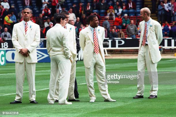 Mark Wright and John Barnes with fellow Liverpool team mates on the pitch at Wembley before the start of the 1996 FA Cup final against Manchester...
