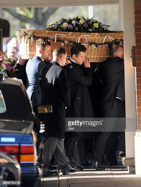 Mark Wright and other pallbearers carry the woven coffin of Nanny Pat during her funeral on January 8 2016 in London England