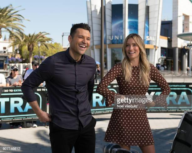 """Mark Wright and Renee Bargh visit """"Extra"""" at Universal Studios Hollywood on March 5, 2018 in Universal City, California."""