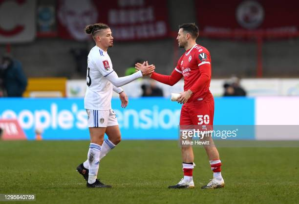 Mark Wright of Crawley Town interacts with Kalvin Phillips of Leeds United at full-time after the FA Cup Third Round match between Crawley Town and...