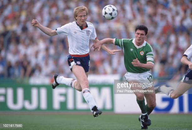 Mark Wright of England and Frank Stapleton of the Republic of Ireland battle for the ball during the UEFA Euro 88 Group 2 match at the Neckarstadion...