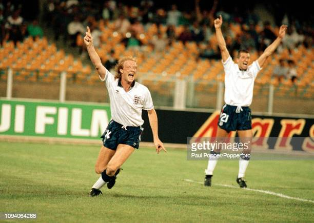 Mark Wright of England celebrates after scoring during the 1990 FIFA World Cup Group F match between England and Egypt at the Stadio Sant'Elia on...