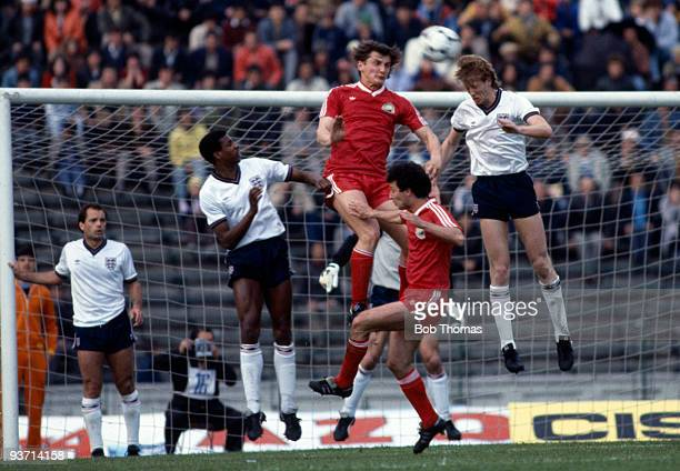 Mark Wright of England heads away from Marcel Coras of Romania during their World Cup Qualifying match held in Bucharest Romania on 1st May 1985 The...
