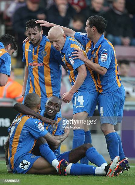Mark Wright of Shrewsbury Town is congratulated by teammates Aaron Wildig Matt Richards Sean McAllister and Marvin Morgan after scoring his and his...