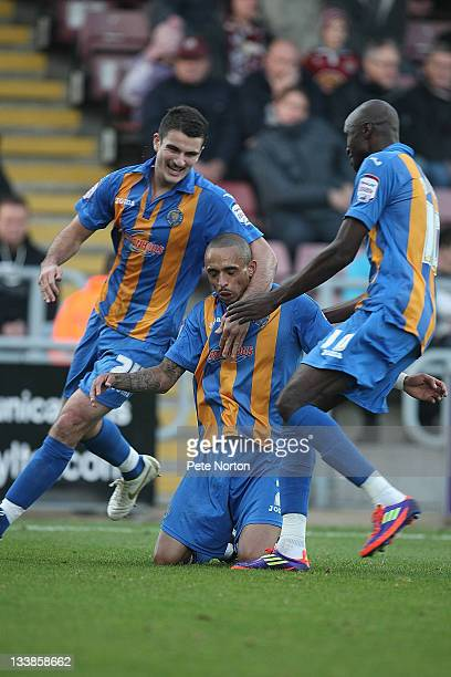 Mark Wright of Shrewsbury Town is congratulated by teammates Terry Gornell and Marvin Morgan after scoring his and his sides second goal during the...