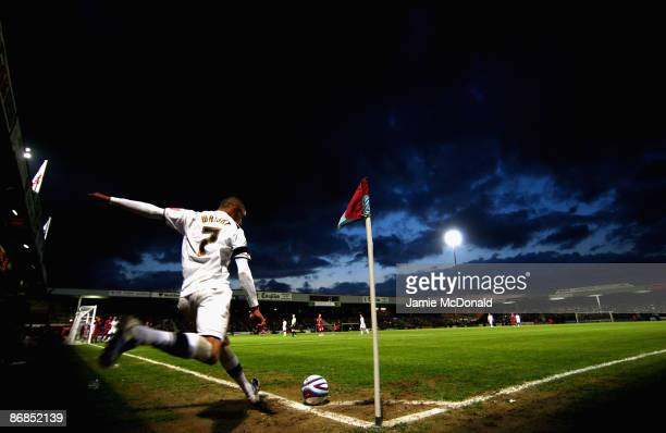 Mark Wright of the MK Dons takes a corner during the Coca-Cola Football League One play off semi-final, first leg match between Scunthorpe United and...
