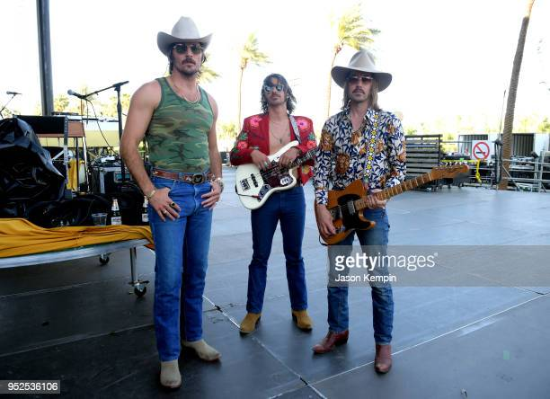 Mark Wystrach Cameron Duddy and Jess Carson of Midland pose onstage during 2018 Stagecoach California's Country Music Festival at the Empire Polo...