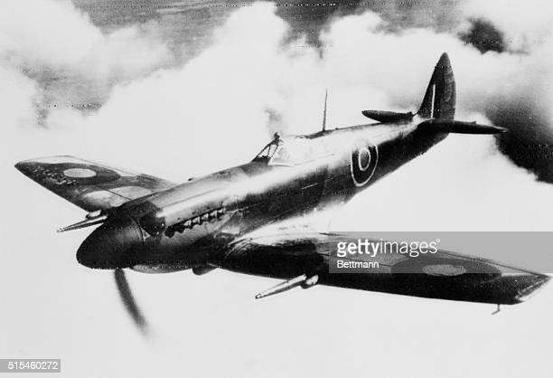A Mark XII Spitfire aircraft designed for low altitude work flies above the clouds Its wing tips are clipped the top of its rudder now comes to a...