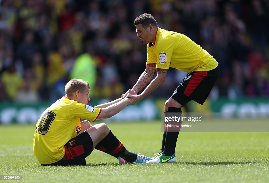 Mark Yeates Of Watford Tries To Pull Up A Dejected Matej
