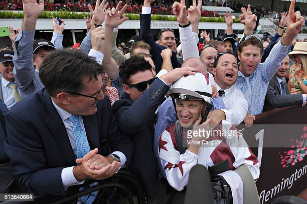 Mark Zahra celebrates with owners after riding Palentino to win Race 7 the Australian Guineas during Melbourne Racing at Flemington Racecourse on...