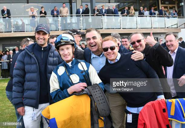Mark Zahra poses with Sam Freedman and connections after riding Le Don De Vie in Race 9, the Sungold Milk Warrnambool Cup, during the Warrnambool...