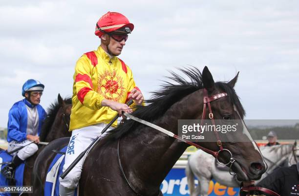 Mark Zahra returns to the mounting yard on Hawkshot after winning Magnum Equine 2YO Maiden Plate at SportsbetBallarat Racecourse on March 20 2018 in...