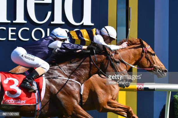 Mark Zahra riding Gailo Chop defeats Katelyn Mallyon riding Johannes Vermeer in Race 7 Ladbrokes Stakes during Melbourne Racing on Caulfield Guineas...