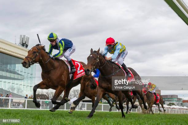 Mark Zahra riding Merchant Navy defeats Dwayne Dunn riding Booker in Race 4 McNeil Stakes during Melbourne Racing at Caulfield Racecourse on...