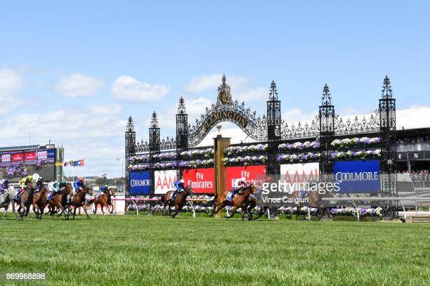 Mark Zahra riding Merchant Navy defeats Stephen Baster riding Invincible Star in Race 5 Coolmore Stud Stakes on Derby Day at Flemington Racecourse on...