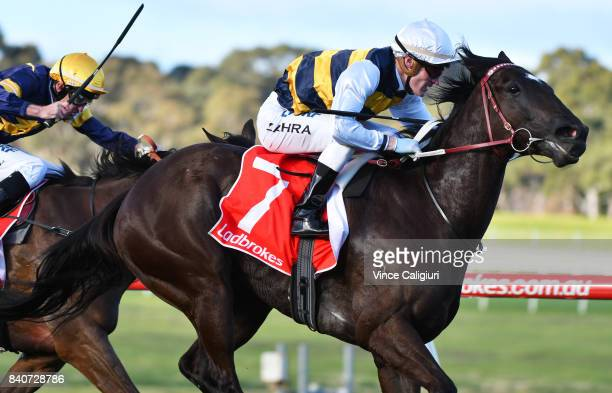 Mark Zahra riding Night's Watch wins Race 8 during Melbourne Racing at Sandown Hillside on August 30 2017 in Melbourne Australia
