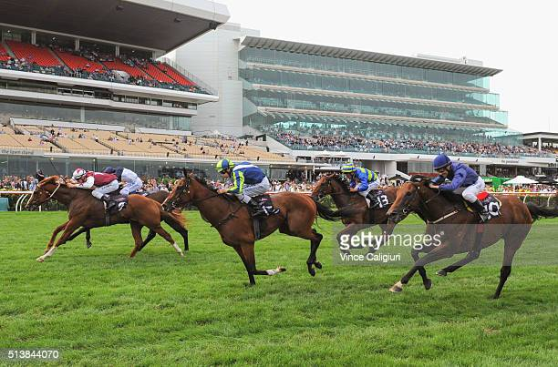 Mark Zahra riding Palentino defeats Craig Newitt riding Tarzino and Damian Lane riding Risque in Race 7 the Australian Guineas during Melbourne...