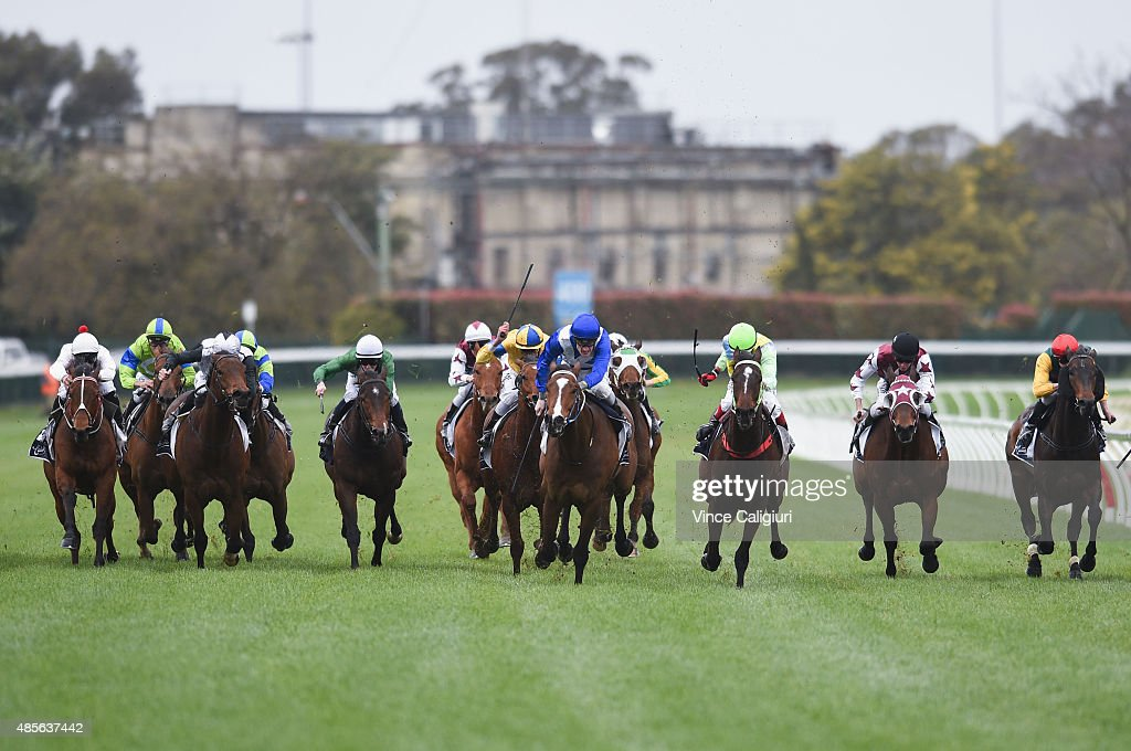 Mark Zahra riding Real Time (blue ctr) winning Race 3 during Melbourne racing at Caulfield racecource on August 29, 2015 in Melbourne, Australia.