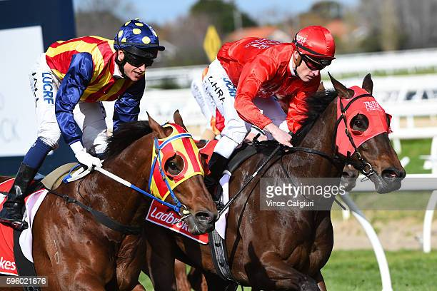 Mark Zahra riding Redzel defeats Nicholas Hall riding Under the Louvre in Race 5 The Resimax Stakes during Melbourne Racing at Caulfield Racecourse...