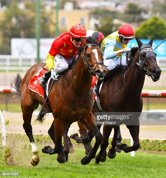 Mark Zahra riding Russian Revolution defeats Damian Lane riding Heatherly in Race 5 Mitty's McEwen Stakes during Melbourne Racing at Moonee Valley...