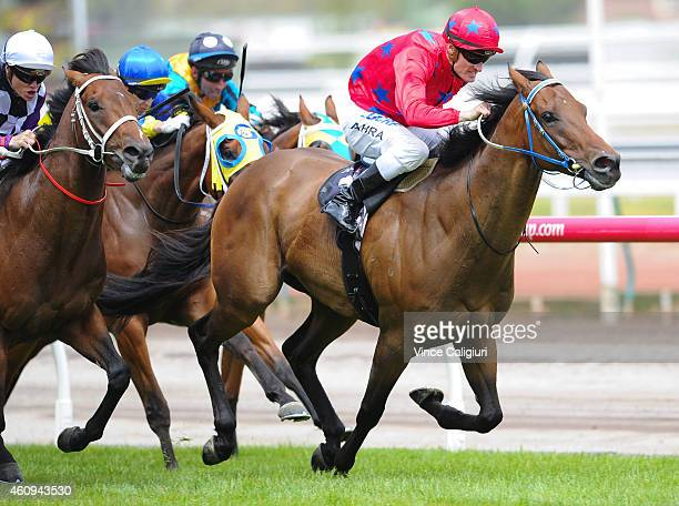 Mark Zahra riding The Bowler winning Race 4 during New Years Day racing at Flemington Racecourse on January 1 2015 in Melbourne Australia